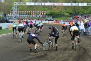 In this bizarre incident, one racer's handlebars became lodged in the tire of one of his opponents.