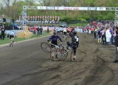 While the mounted racer rode on for several more feet, eventually the bicycles were separated and both racers continued.